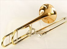 Какой инструмент возник из трубы? Тромбон музыкальный инструмент. Тромбон фото.